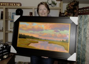 A Hartwell House Inn guest shows off her latest acquisition - A mary Byrom painting purchased at Beth Ellis Cove Gallery in Perkins Cove, Ogunquit